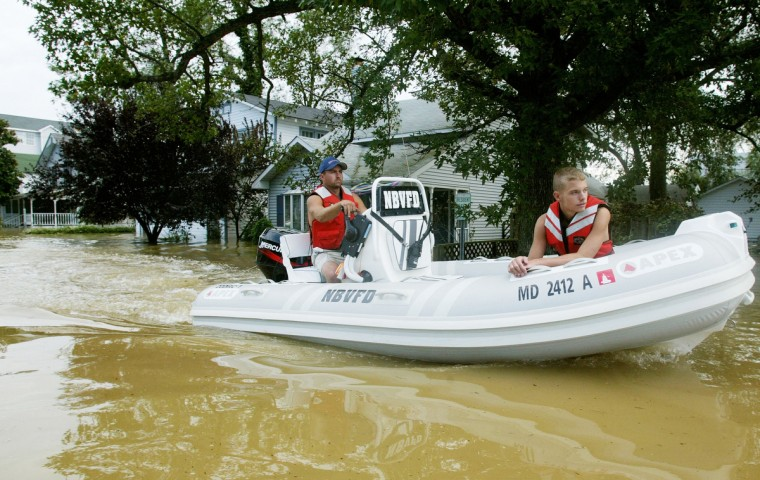 A rescue boat motors down a flooded street September 19, 2003 in North Beach, Maryland. Hurricane Isabel gave the Chesapeake Bay area the highest flooding in recent memory. (Mark Wilson/Getty Images)