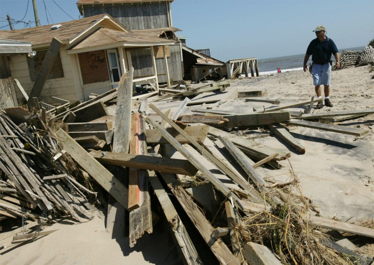 Carl Crabtree surveys damage to his cottage hotel Crabtree Court September 19, 2003 in Nags Head, North Carolina. Crabtree says that FEMA estimated the damage to his array of cottages and bungalows of over a million dollars. Residents of the Outer Banks spent the day cleaning up after Hurricane Isabel, which lashed the area September 18 and caused flooding and heavy damage. (Chris Hondros/Getty Images)