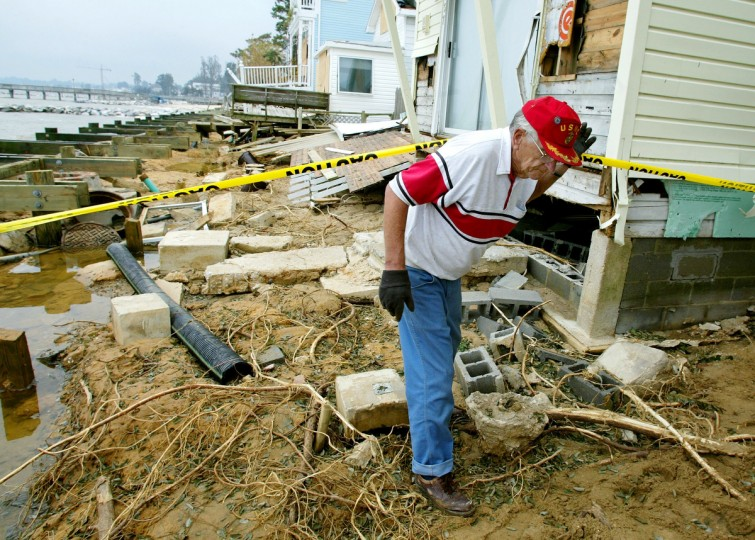 Charles Locker inspects damage to a house caused by the storm surge of Hurricane Isabel September 22, 2003 in North Beach, Maryland. Many homes along the Chesapeake Bay were flooded from the historial high tide. (Mark Wilson/Getty Images)