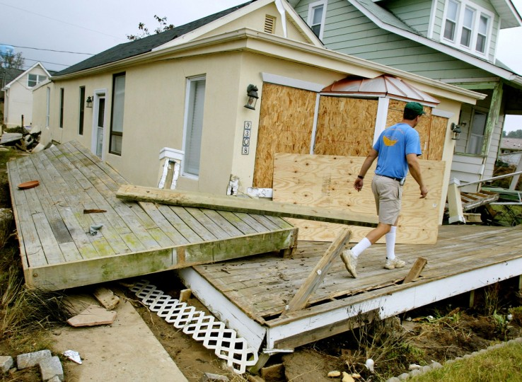 Kelly Krick inspects homes damaged by the storm surge of Hurricane Isabel September 22, 2003 in North Beach, Maryland. Many homes along the Chesapeake Bay were flooded from the historcial high tide. (Mark Wilson/Getty Images)