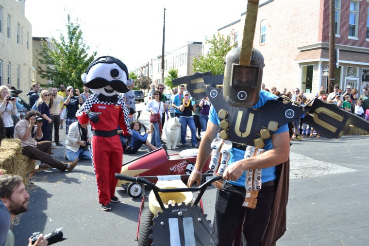 It's a battle of the brews at Hampdenfest's Toilet Bowl Race. (Steve Earley/Baltimore Sun)