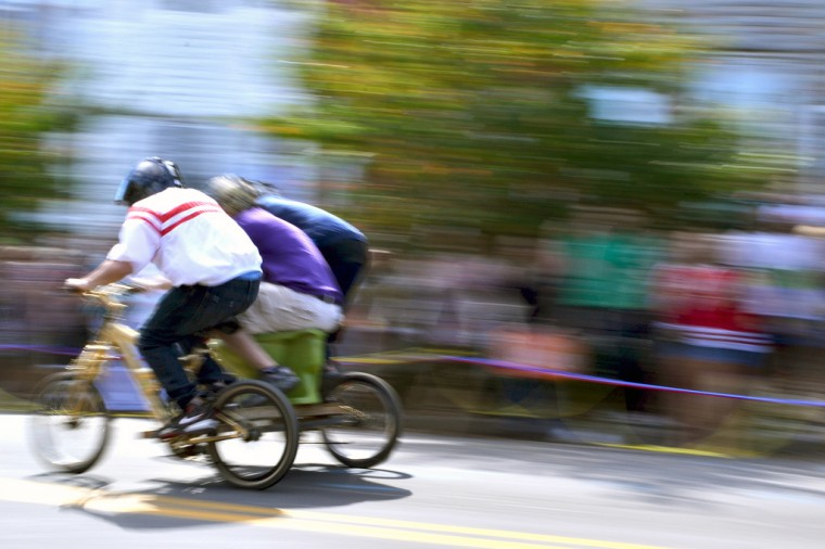 Hampdenfest Toilet Bowl Race contestants speed down Chestnut Avenue. (Steve Earley/Baltimore Sun)