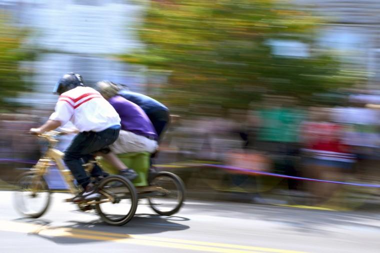Hampdenfest Toilet Bowl Race contestants speed down Chestnut Avenue. (Steve Earley/Baltimore Sun)