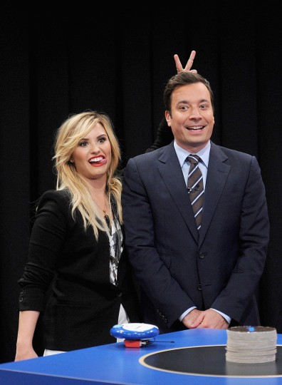 "Demi Lovato and host Jimmy Fallon attend ""Late Night With Jimmy Fallon"" at Rockefeller Center in New York City. (Jamie McCarthy/Getty Images)"
