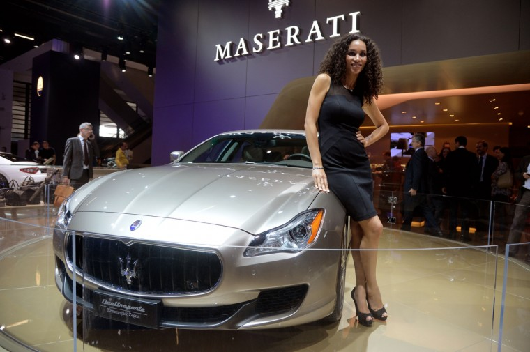 A model stands beside the Maserati Quattroporte Ermenegildo Zegna at the IAA International Automobile Exhibition on September 10, 2013 in Frankfurt, Germany. (Thomas Lohnes/Getty Images)