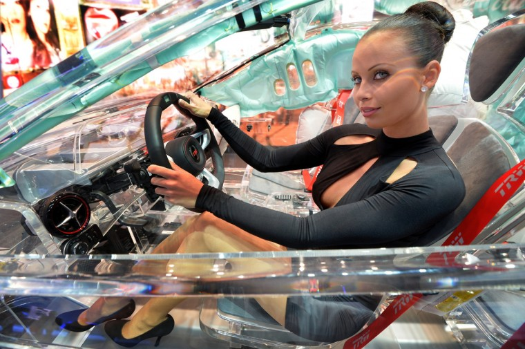 A model sits in a acrylic glass car body that shows the car technik at the IAA international automobile show on September 11, 2013 in Frankfurt, Germany. The 2013 IAA will be open to the public from September 12-22. (Thomas Lohnes/Getty Images)