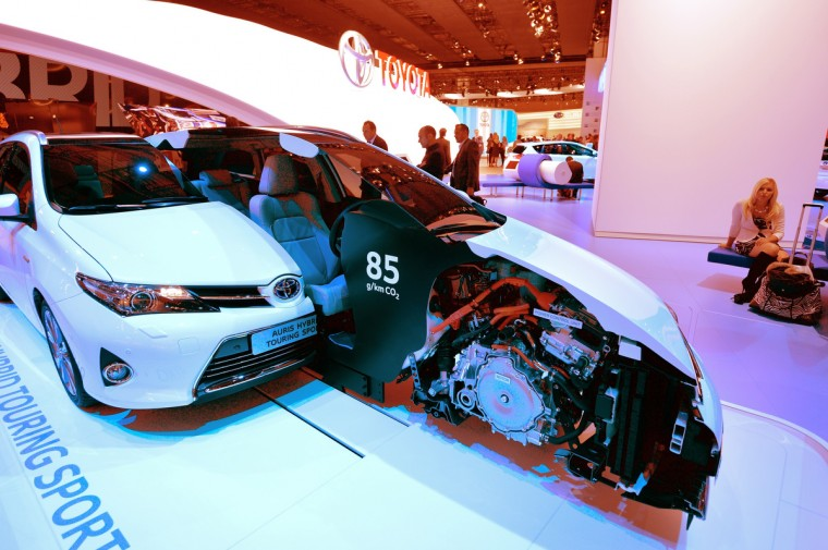 Visitors looks at an Nissan Auris Hybrid model at the IAA international automobile show on September 11, 2013 in Frankfurt, Germany. The 2013 IAA will be open to the public from September 12-22. (Thomas Lohnes/Getty Images)
