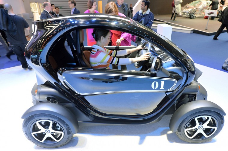 A visitor sits in the Renault Twizy electric drive at the IAA international automobile show on September 11, 2013 in Frankfurt, Germany. The 2013 IAA will be open to the public from September 12-22. (Thomas Lohnes/Getty Images)