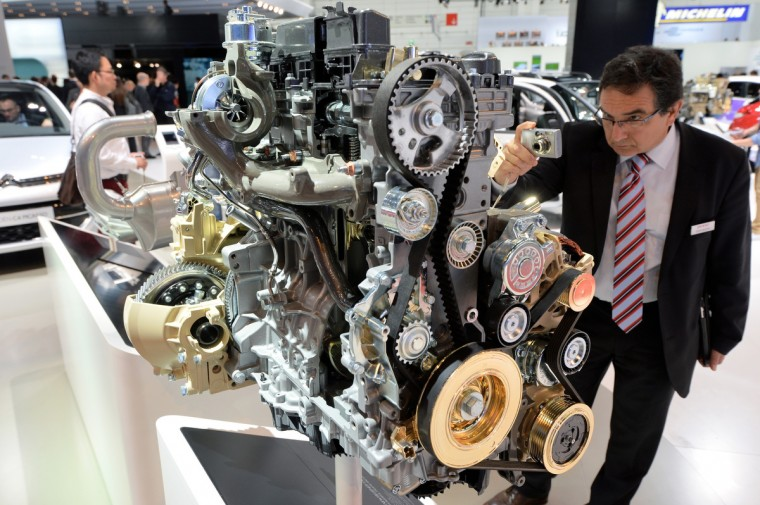 A visitor looks at an Citroen diesel enging at the IAA international automobile show on September 11, 2013 in Frankfurt, Germany. (Thomas Lohnes/Getty Images)