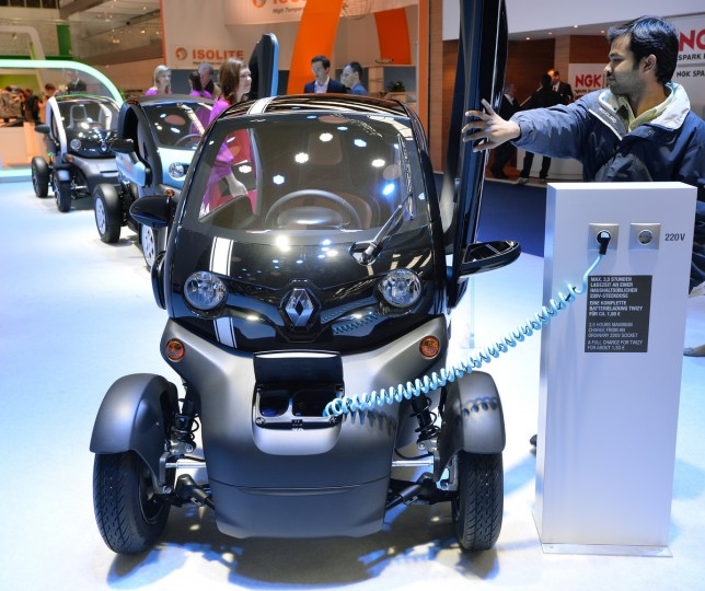 A visitor closes the dor of the Renault Twizy electric drive at the IAA international automobile show on September 11, 2013 in Frankfurt, Germany. The 2013 IAA will be open to the public from September 12-22. (Thomas Lohnes/Getty Images)