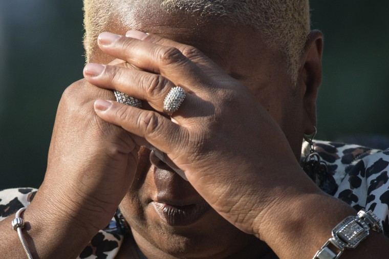 Chundera Epps, sister of victim Christopher Epps, mourns during the ringing of the first bell during the 9/11 Memorial ceremonies marking the 12th anniversary of the 9/11 attacks on the World Trade Center on September 11, 2013 in New York City. (Adrees Latif/Reuters)