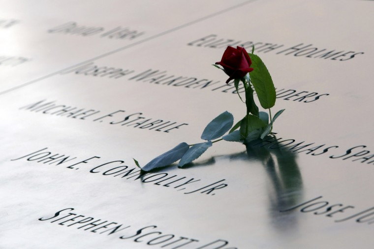 A rose is left by the names engraved in the South Pool of the 9/11 Memorial during ceremonies for the twelfth anniversary of the terrorist attacks on lower Manhattan at the World Trade Center site on September 11, 2013 in New York City. . (Mary Altaffer/Getty Images)