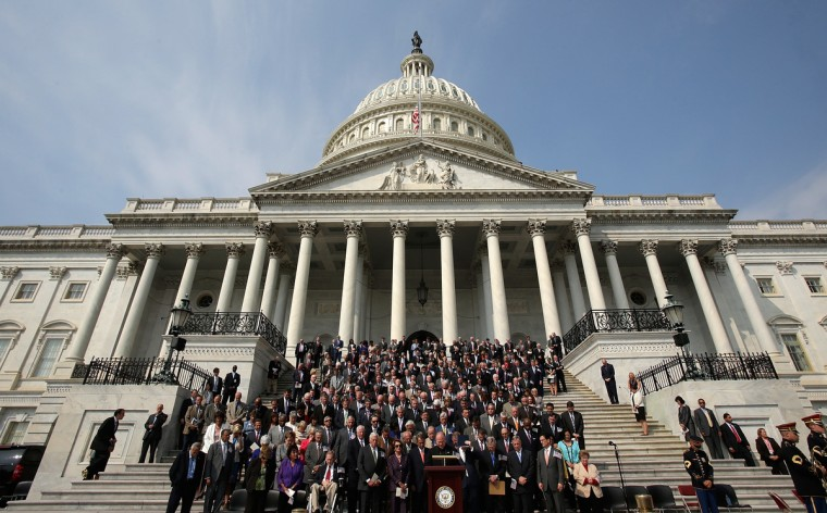 Members of Congress observe a moment of silence during a September 11th remembrance ceremony on the steps of the U.S. Capitol September 11, 2013 in Washington, DC. (Win McNamee/Getty Images)