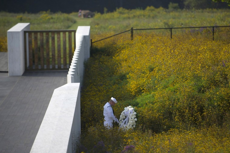 A Navy honor guard prepares a wreath before the arrival of United States Secretary of the Interior Sally Jewell at the Flight 93 National Memorial during ceremonies commemorating the 12th anniversary of the 9/11 attacks on September 11, 2013 in Shanksville, Pennsylvania. (Jeff Swensen/Getty Images)