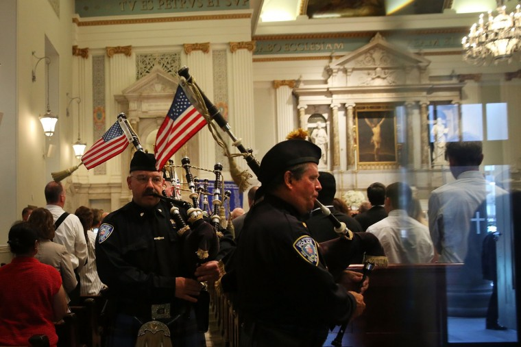 Members of the Port Authority Pipes and Drums perform during a Port Authority Interfaith Remembrance Service at St. Peter's Church on September 11, 2013 in New York City. The service, only blocks from where the Twin Towers once stood, honors the 84 Port Authority employees who were killed on September 11, 2001 in the terrorist attacks on the World Trade Center, as well as the victims of the 1993 World Trade Center bombing. (Spencer Platt/Getty Images)