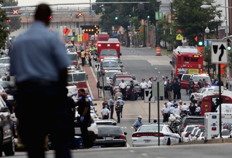 Emergency vehicles and law enforcement personnel respond to a reported shooting at the Washington Navy Yard September 16, 2013 in Washington, DC. According to news reports several people were shot with a shooter still active. (Alex Wong/Getty Images)