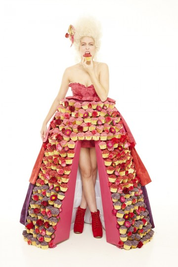 A model wears a dress made out of 300 cupcakes at the Food Network Cupcake Showcase in London, England. (Nicky Johnston/Food Network UK via Getty Images)