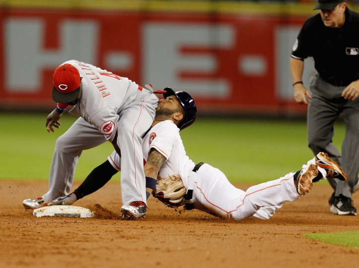 Jonathan Villar #6 of the Houston Astros is tagged out by Brandon Phillips #4 of the Cincinnati Reds attempting to stretch a single in to a double in the first inning at Minute Maid Park in Houston, Texas. (Bob Levey/Getty Images)