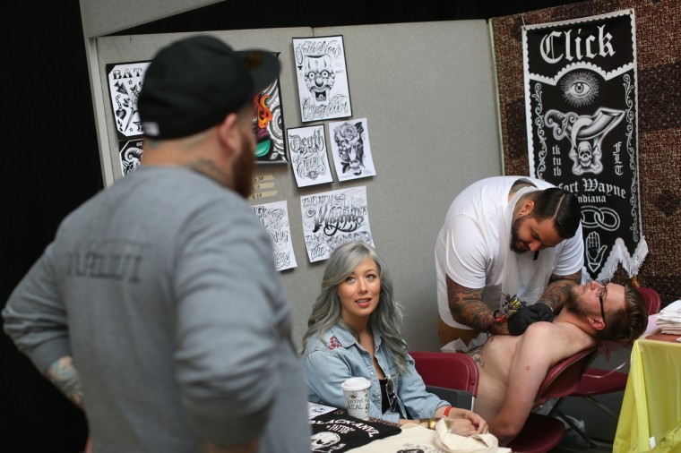 A tattoo enthusiast has his chest tattooed at the London Tattoo Convention in Tobacco Dock on September 27, 2013 in London, England. (Oli Scarff/Getty Images)