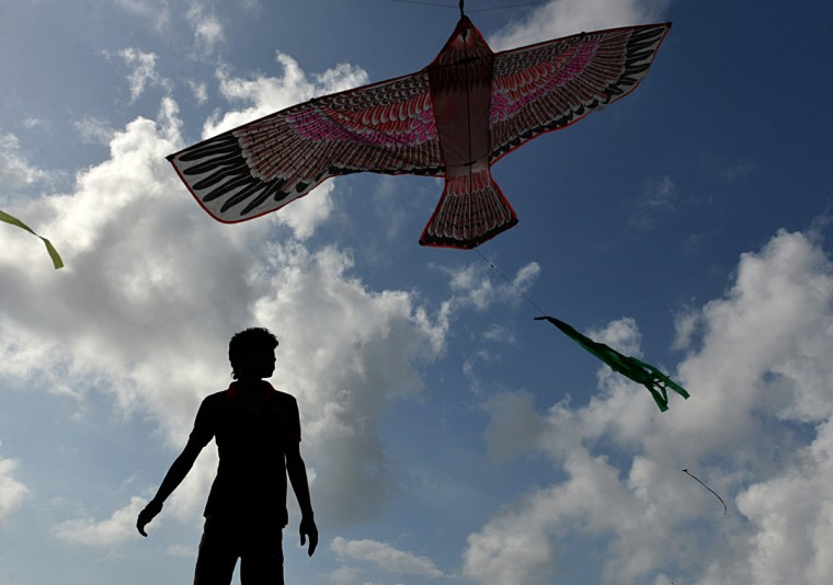 A Sri Lankan man plays with a kite at the Galle Face promenade in the capital of Colombo. After crushing Tamil rebels four years ago Sri Lanka expected to become South Asia's tiger economy, but exuberance has given way to mediocre growth and fears of more trouble ahead. (Ishara S. Kodikara/Getty Images)