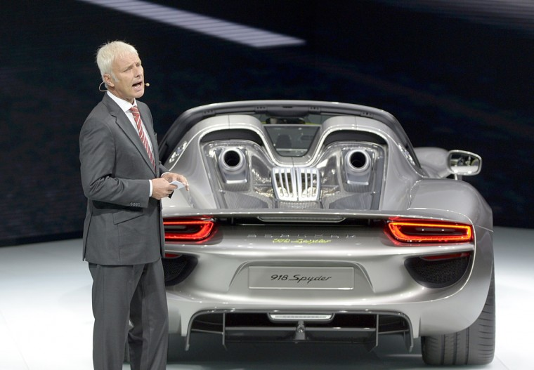 Matthias Mueller, member of the board of directors for strategy of Porsche Automobil Holding SE and CEO of Porsche AG, presents the new 918 Spyder car. (Johannes Eisele/Getty images)
