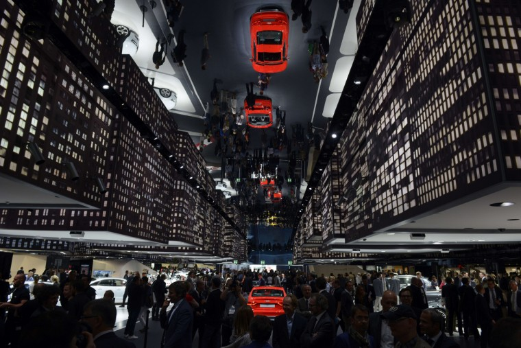 Audi cars are reflected in a mirror at the booth of Audi during the media day of the IAA (Internationale Automobil Ausstellung) international motor show. (Johannes Eisele/Getty images)
