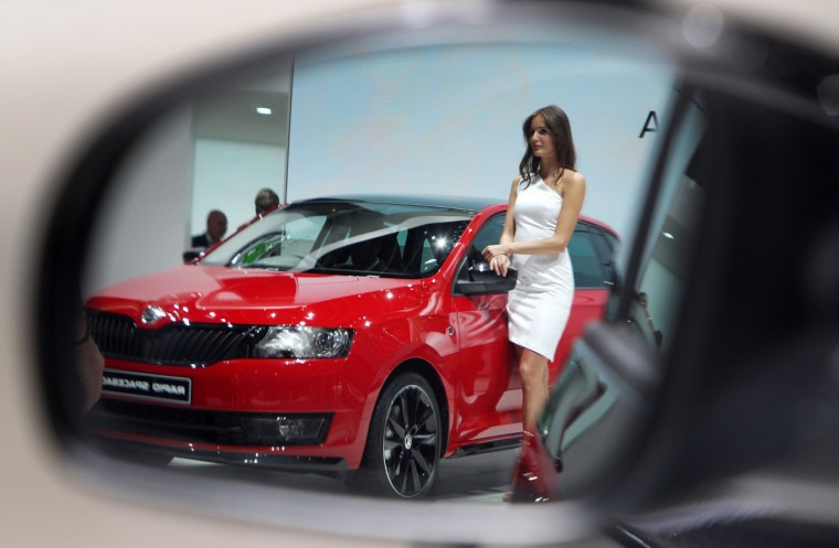 A model presenting a Skoda Rapid is refelected in a rearview mirror of a car at the IAA (Internationale Automobil Ausstellung) in Frankfurt/Main,central Germany, on September 11, 2013. According to the organiser, more than 1,000 exhibitors from 35 countries will present their products during the show running from September 12 to 22, 2013. (Daniel Roland/Getty images)