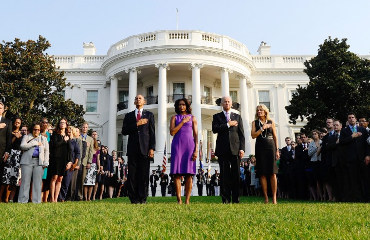 US President Barack Obama, First Lady Michelle Obama, Vice President Joe Biden and Jill Biden observe a moment of silence to mark the 12th anniversary of the 9/11 attacks on the South Lawn of the White House in Washington, DC, on September 11, 2013. (Jewel Samad/Getty Images)