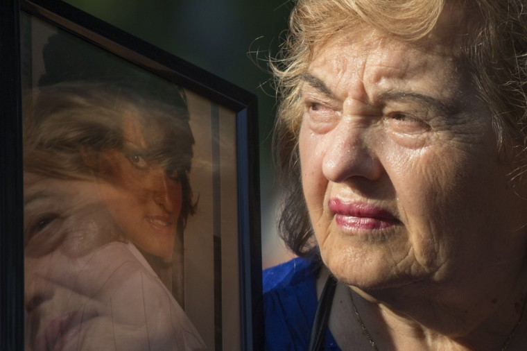 Ester DiNardo, mother of Marisa DiNardo, clutches her image while attending the 9/11 Memorial ceremonies marking the 12th anniversary of the 9/11 attacks on the World Trade Center in New York on September 11, 2013. (Adrees Latif/Reuters)