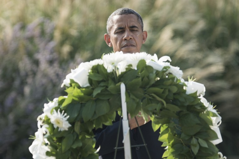 US President Barack Obama places a wreath at the Pentagon 9/11 Memorial park to mark the 12th anniversary of the 9/11 attacks at the Pentagon in Washington, DC, on September 11, 2013. (Brendan Smialowski/Getty Images)