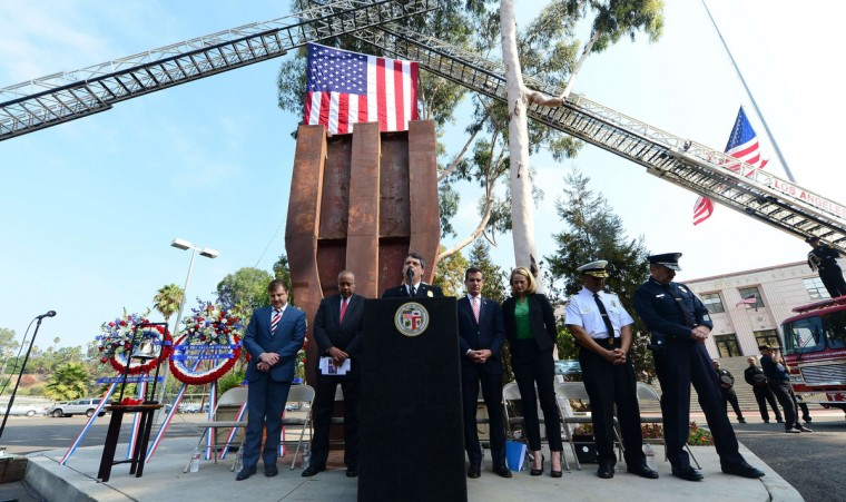 Los Angeles city officials, including Mayor Eric Garcetti (4th R) attend a memorial in front of the World Trade Center Memorial at the Los Angeles Fire Department Frank Hotchkin Memorial Training Center in Los Angeles on September 11, 2013, to commemorate the 9/11 attacks. The memorial is dedicated to the 343 New York firefighters who lost their lives at the World Trade Center disaster. (Frederic J. Brown/Getty Images)