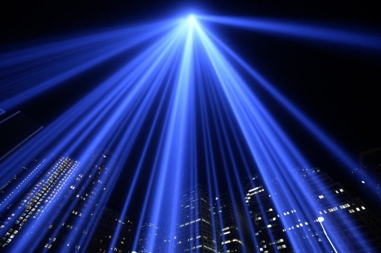 The Tribute in Light illuminates the sky in New York on September 11, 2013 on the 12th anniversary of the September 11, 2001 attacks. The tribute, an art installation of the Municipal Art Society, consists of 88 searchlights placed next to the site of the World Trade Center creating two vertical columns of light in remembrance of the 2001 attacks. (Timothy Clary/Getty Images)