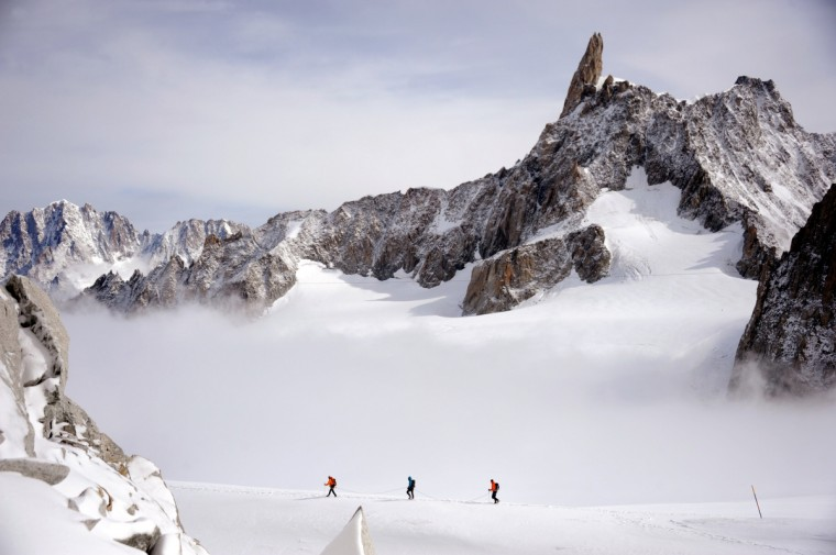 A rope of three climbers walk at 3400m near the Giant's tooth, in the Mont Blanc massif in France and Italy. (Jean Pierre ClatotJ/Getty Images)