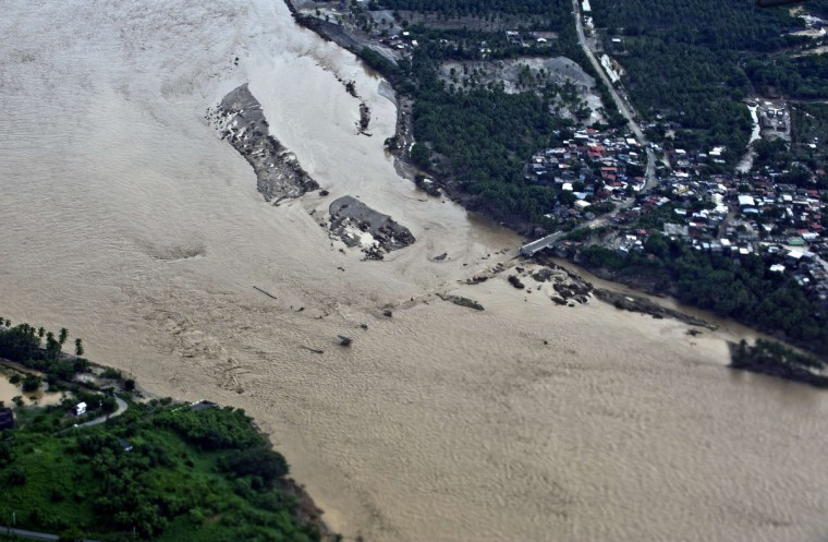 Aerial view of a fallen bridge over the Papagayo River in Acapulco, state of Guerrero, Mexico, on September 17, 2013 as heavy rains hit the country. Mexican authorities scrambled Tuesday to launch an air lift to evacuate tens of thousands of tourists stranded amid floods in the resort of Acapulco following a pair of deadly storms. (Ronaldo Schemidt/Getty Images)