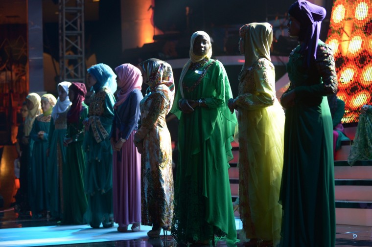 Contestants of the Muslimah World pageant take part in a rehearsal for the grand final of the contest in Jakarta. The finale of a beauty pageant exclusively for Muslim women will take place in the Indonesian capital on September 18, in a riposte to the Miss World contest in Bali that has drawn fierce opposition from Islamic radicals. (Adek Berry/Getty Images)