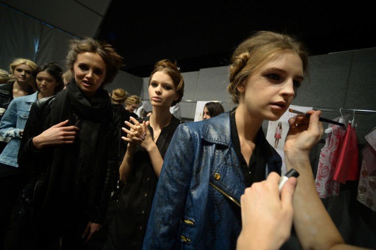 Models get ready backstage before the show for fashion house Blugirl as part of the spring/summer 2014 ready-to-wear collections during the fashion week in Milan. (Filippo Monteforte/Getty images)