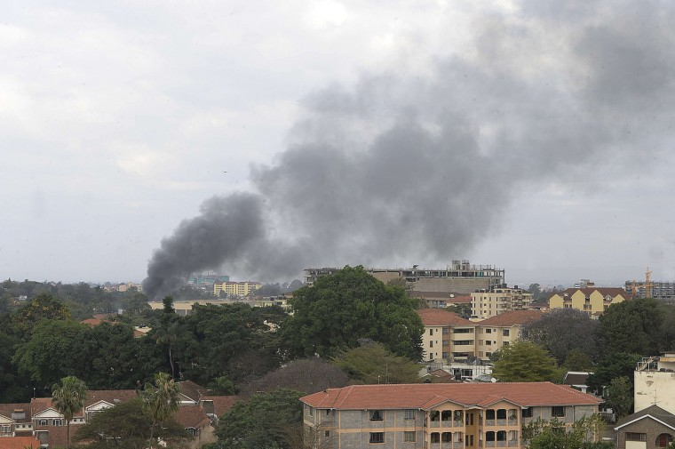 Smoke rises on September 23, 2013 from the beseiged Westgate shopping mall in Nairobi following a loud explosion. Kenyan security forces were locked in a fierce, final battle with Somali Islamist gunmen inside the upmarket mall on September 23 as huge explosions and a barrage of heavy gunfire echoed out of the complex. A thick cloud of black smoke billowed out from the Westgate mall as Kenyan officials said the 50-hour-long siege -- which has seen the gunmen massacre at least 62 people and take dozens more hostage -- was close to being resolved. Somalia's Al-Qaeda-linked Shebab insurgents have claimed the attack, which began midday on September 21, when the gunmen marched into the complex, firing grenades and automatic weapons and sending panicked shoppers fleeing. (Simon Maina/Getty images)