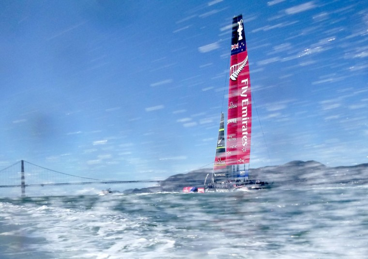 With the Golden Gate Bridge in the background, Emirates Team New Zealand heads to the start of America's Cup race 18 in San Francisco. Following seven consecutive wins, Oracle Team USA is now tied with New Zealand heading into Wednesday's final race. (Noah Berger/Getty Images)