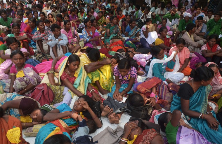 Indian indigenous protesters rest as they participate in a rally in Kolkata. Hundreds of indigenous groups from different parts of the state came to demand that their language Ol Chiki should be included in the state level education system, and made other demands for the education. (Dibyangshu Sarkar/Getty Images)