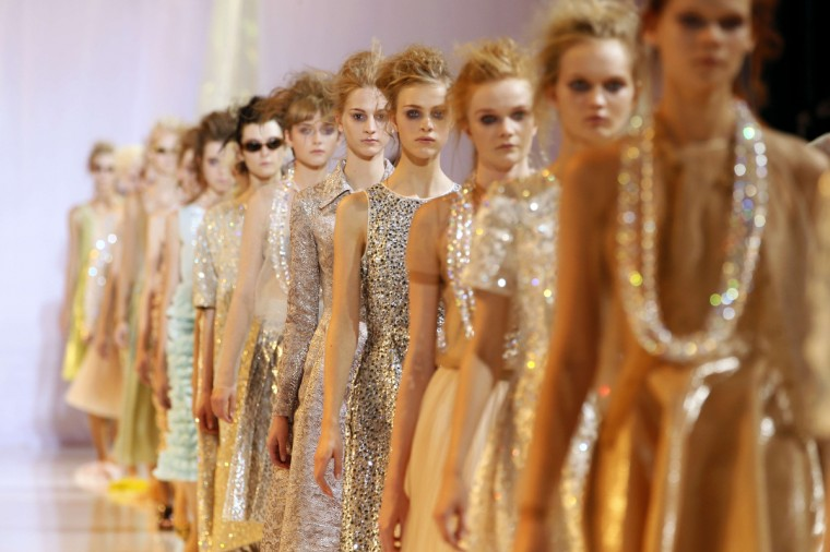 Models present creations by Italian-Swedish Marco Zanini for Rochas during the 2014 Spring/Summer ready-to-wear collection fashion show in Paris. (Patrick Kovarik/Getty Images)