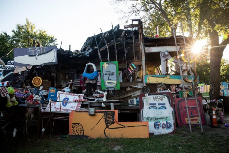 "An art instillation created amongst the ruins of a partially burned-down home sits amongst the ""Heidelberg project,"" which is an ""open air art environment"" centered around one block in Detroit, on September 3, 2013 in Detroit, Michigan. The Heidelberg project is the brain child of Tyree Guyton. He and other artists use the urban environment (including homes and sidewalks) as a canvas for art, which they make using paint and recycled materials. (Andrew Burton/Getty Images)"