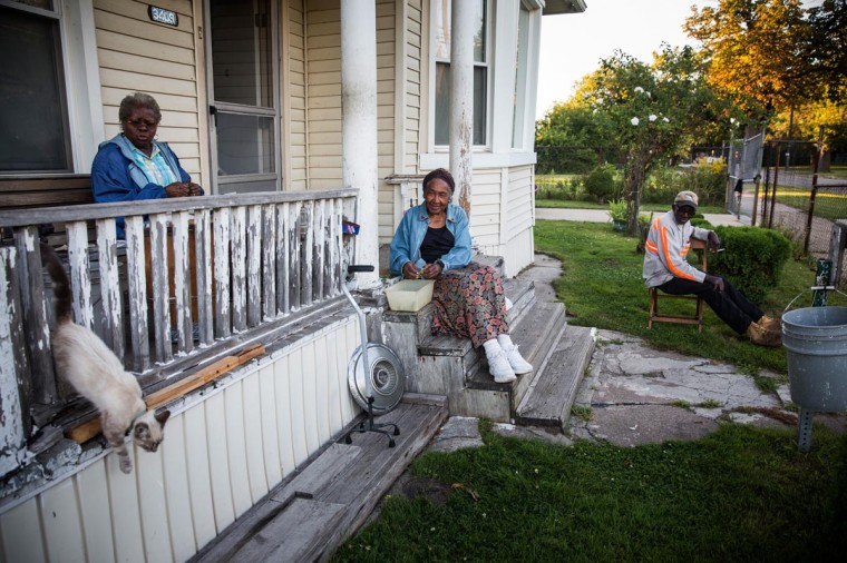 John Fullmore (R), sits on his porch with his wife Magnolia Fullmore (L) and their neighbor Pinkie Dawkin (C) on September 3, 2013 in Detroit, Michigan. Fullmore, who is originally from Georgia, moved to Detroit in 1958, where he met his wife. He worked as a metal finisher, she worked on the production line at Chrysler motors. They bought their home in 1965. (Andrew Burton/Getty Images)