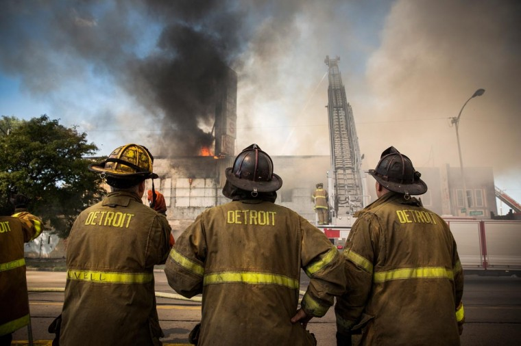 Members of the Detroit Fire Department fight a two-alarm fire that broke out in an abandoned building on September 4, 2013 in the Six Mile Gratiot neighborhood of Detroit, Michigan. Detroit has an estimated 78,000 abandoned buildings across its 142 square miles. (Andrew Burton/Getty Images)