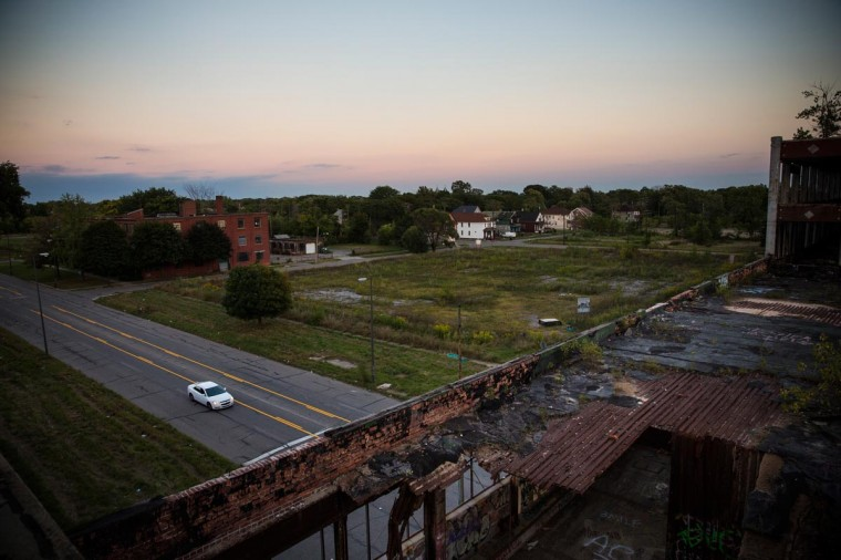 A car drives past the abandoned Packard Automotive Plant on September 4, 2013 in Detroit, Michigan. (Andrew Burton/Getty Images)
