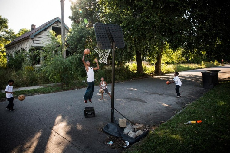 Boys play basketball on the street on September 5, 2013 in Detroit, Michigan. (Andrew Burton/Getty Images)