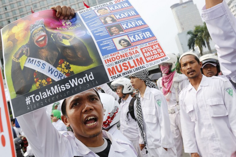 A member of an Indonesian hardline Islamic group holds up a sign during a protest against the forthcoming Miss World competition on September 6, 2013 in Jakarta, Indonesia. Hundreds of members of hardline Islamic groups have been protesting against the holding of the 63rd annual edition of the Miss World pageant, which is set to start this Sunday, saying that the competition is immoral, indecent and is counter to Islamic values. (Ed Wray/Getty Images)