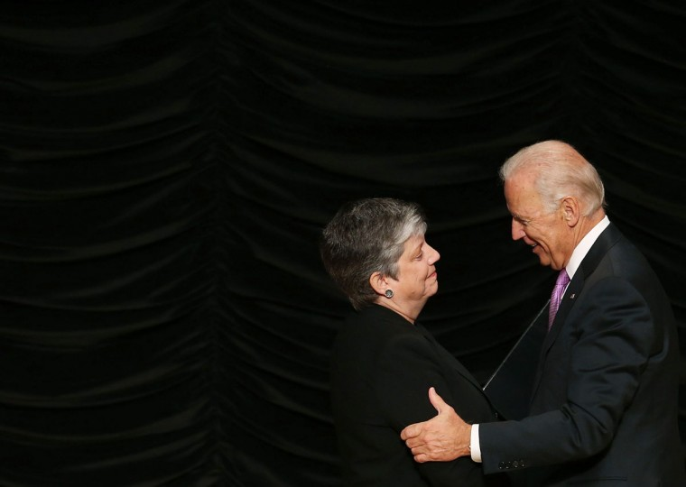 Secretary of Homeland Security Janet Napolitano is congratulated by U.S. Vice President Joe Biden (right) after delivering her farewell speech at the Ronald Reagan Building, September 6, 2013 in Washington, D.C. Friday was Secretary Napolitano's last day on the job before becoming head of the University of California.(Mark Wilson/Getty Images)