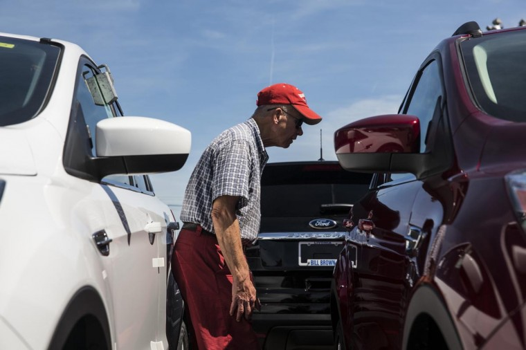 Harry Lindback, of Dearborn Heights, MI, shops for cars at Bill Brown Ford Dealership on September 6, 2013 in Livonia, Michigan. Lindback worked for Ford for 36 years, before retiring 11 years ago. (Andrew Burton/Getty Images)