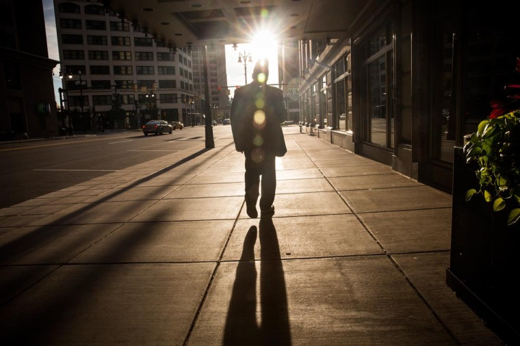 A man walks towards the sun set on September 6, 2013 in Detroit, Michigan. (Andrew Burton/Getty Images)