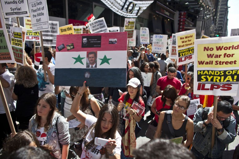 Demonstrators take part in a rally on Times Square September 7, 2013 in New York City. Organizers expect nationwide demonstrations against any U.S. military action in Syria after the reported use of chemical weapons. (Ramin Talaie/Getty Images)